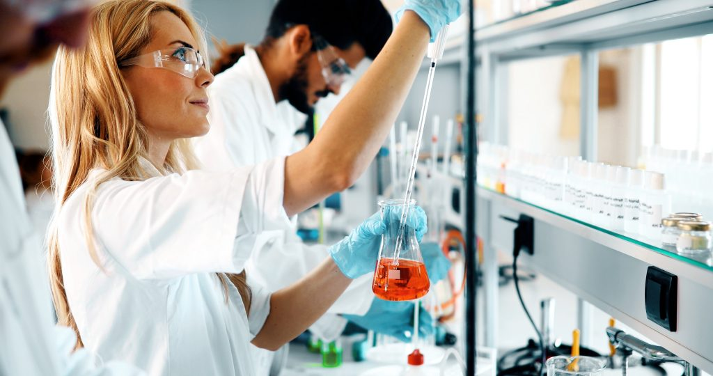 female researcher working in a laboratory image